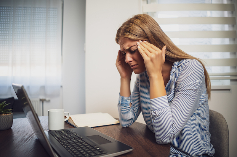 employee looking stressed out depicting worries that  businesses face with cyber security